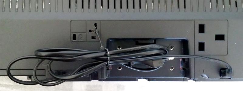 Le câble d'alimentation plié et rangé